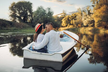 Happy love couple boating on lake, romantic date Reklamní fotografie - 133066893