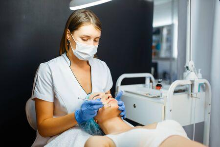 Cosmetician gives botox injection, face care Reklamní fotografie - 133066915