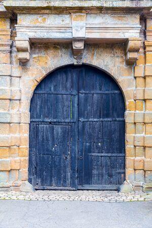 Grunge wooden door, ancient european tourist city
