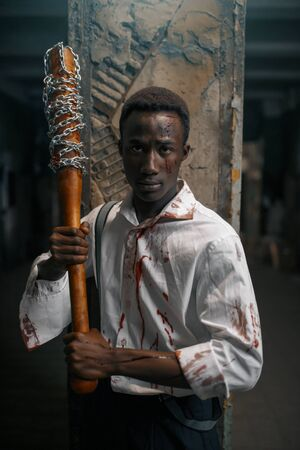 Man with baseball bat, deadly zombie chase 写真素材