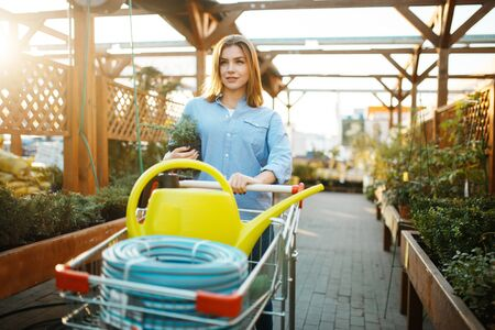 Female customer buying gardening tools, floristry