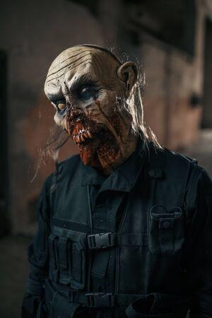 Male zombie walking in abandoned factory 版權商用圖片