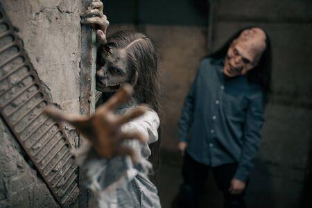 Zombie couple in abandoned factory, devil family 版權商用圖片
