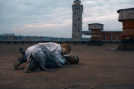 Zombie couple on the roof of abandoned building 版權商用圖片