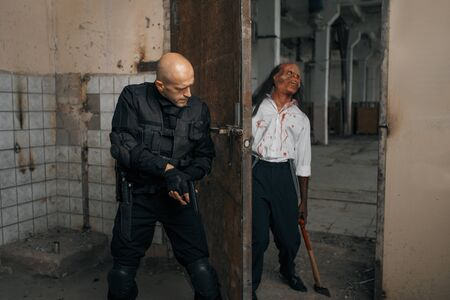 Man trying to kill zombie, nightmare in factory