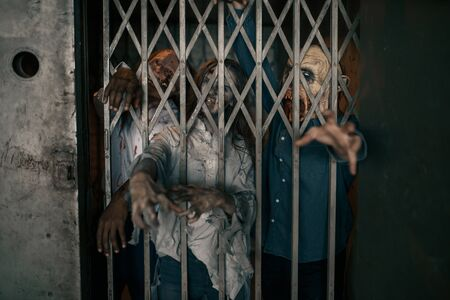 Zombie hands sticking out of the elevator, horror