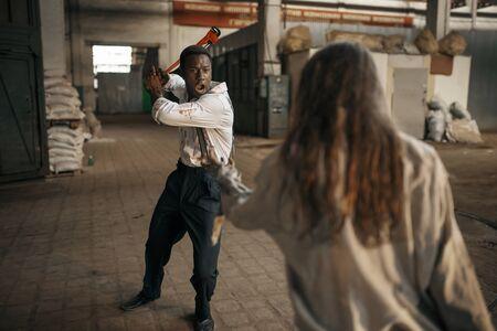 Female zombie fights with hopeless man, apocalypse