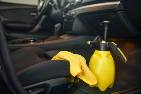 Vehicle interior, rag and spray, car wash service, nobody. Automobile on carwash station, car-wash business concept