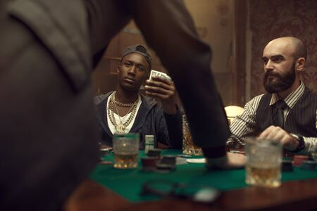 Three poker players in casino, blackjack