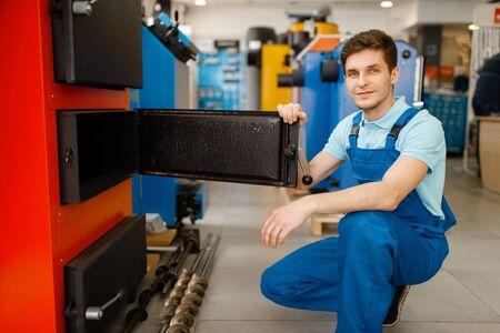 Plumber choosing boiler with furnace, plumbering