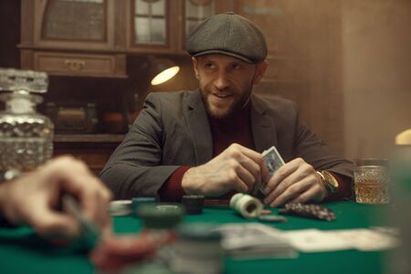 Professional poker player feels the risk, casino 写真素材 - 136088088
