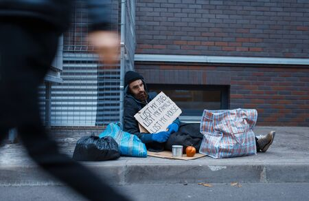 Beggar lost all in his life, poor on city street