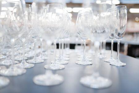 Wine glasses on the shelf closeup, houseware store Foto de archivo