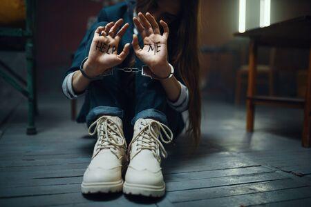 Handcuffed female victim of maniac kidnapper