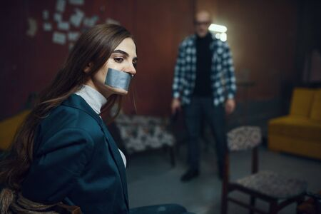 Maniac kidnapper and victim with taped mouth shut