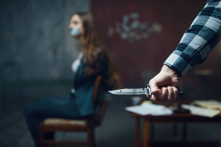 Maniac kidnapper with knife, scared female victim