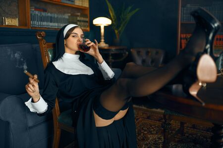 Nun sitting in a depraved pose, attractive sinner