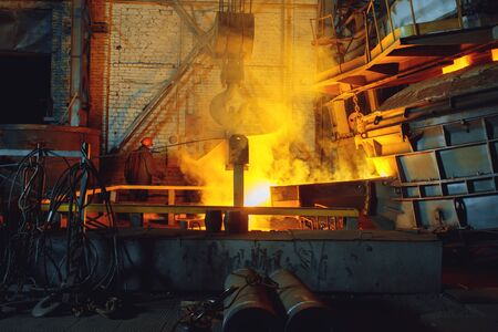 Steel factory, metallurgical or metalworking industry, industrial manufacturing of production on mill, crane over furnace with liquid metal