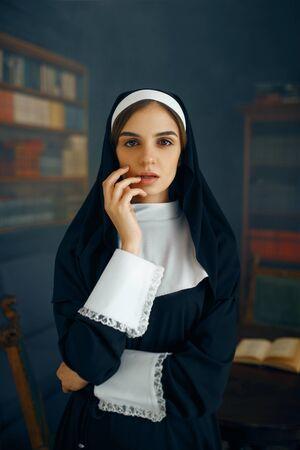 Young nun in a cassock, vicious desires