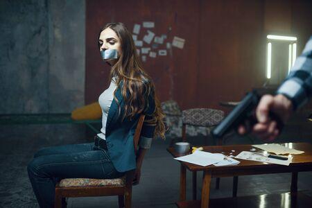Maniac kidnapper with a gun, scared female victim