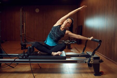Fit girl in sportswear, pilates training in gym Stock Photo