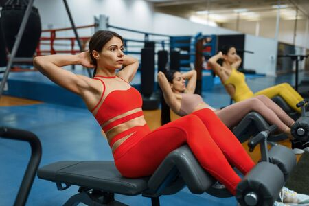 Group of women doing abs exercise in gym Stock fotó