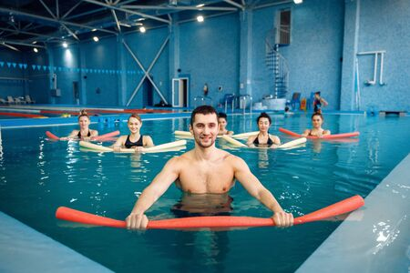 Trainer and female group, workout in the pool