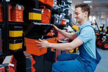 Male employee choosing toolbox in tool store Archivio Fotografico