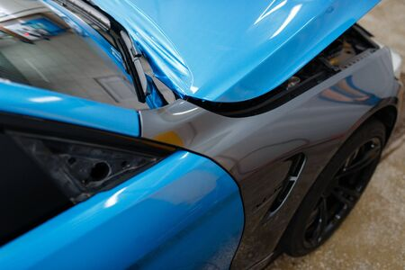 Car wrapping, protective vinyl foil or film coating on the vehicle, nobody. Auto detailing. Automobile paint protection, professional tuning Stock Photo