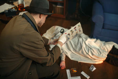 Detective with magnifying glass looking letter