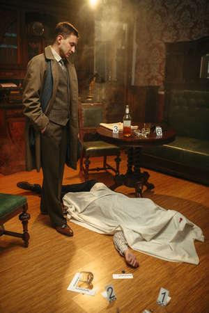 Detective in coat looking on victim, crime scene
