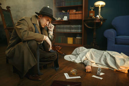 Male detective in gloves thinks at the crime scene