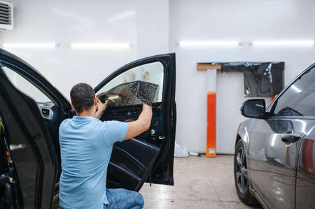 Specialist installs wetted car tinting, tuning