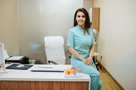 Female gynecologist sitting at the clinic office