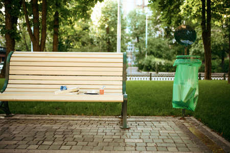 Trash on the bench in park, volunteering motivator