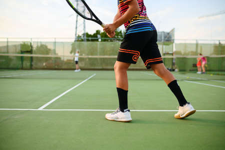 Athletic tennis players, training on outdoor court