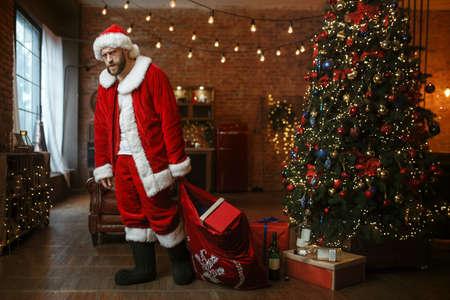 Bad drunk Santa claus brings gifts, nasty party