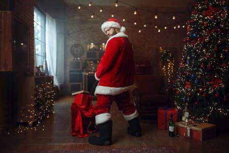 Bad drunk Santa claus pee on gifts
