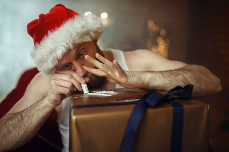 Bad Santa claus takes drugs, cocaine party, humor