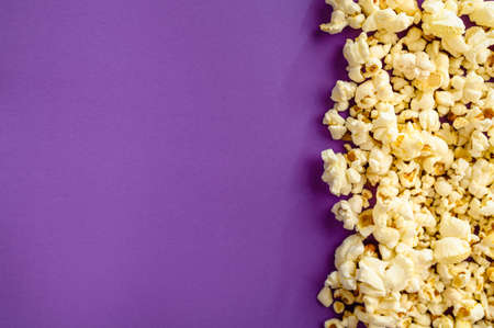 Popcorn border isolated on purple background