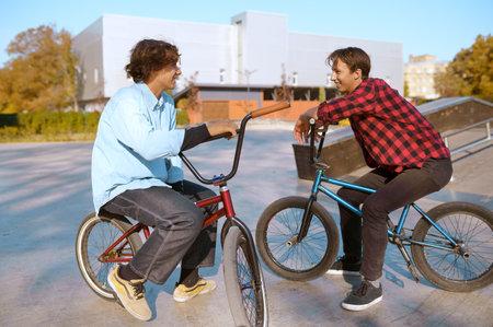 Bmx bikers on bikes, training in skatepark 스톡 콘텐츠