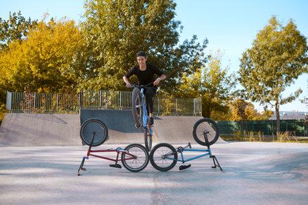 Bmx bikers lifestyle, training in skatepark 스톡 콘텐츠