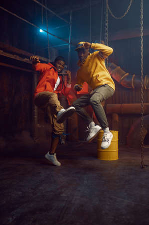 Two stylish rappers, breakdancing in studio