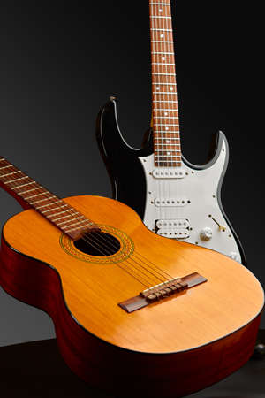 Modern electric and retro acoustic guitars