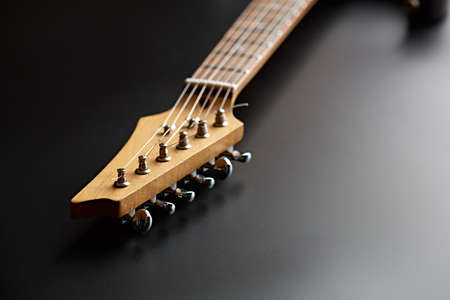 Electric guitar, closeup view on head