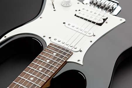 Electric guitar closeup, black background, nobody Zdjęcie Seryjne