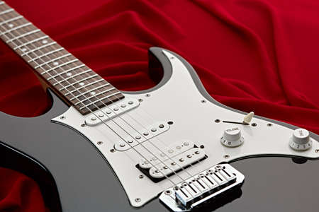 Modern electric guitar, red background