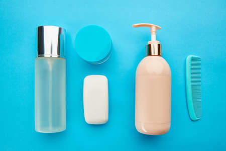 Care products on blue background, nobody Banque d'images
