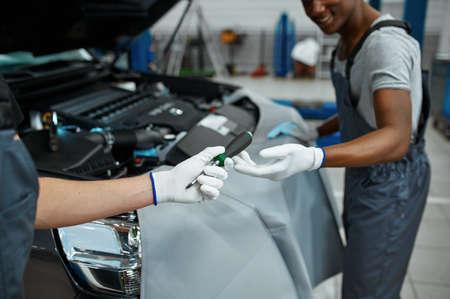 Two male mechanics repairs engine, car service Zdjęcie Seryjne