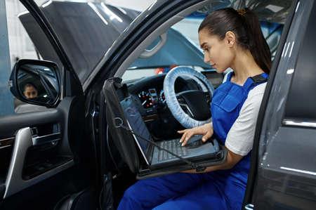 Female mechanic does diagnostics, car service